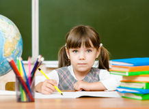Portrait of lovely girl drawing in copybook Stock Images