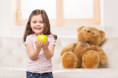 Portrait of lovely girl playing with apple. Royalty Free Stock Images