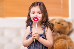 Portrait of lovely girl playing with teddybear. Royalty Free Stock Photography