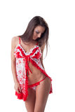 Portrait of lovely girl posing in erotic negligee Royalty Free Stock Photos