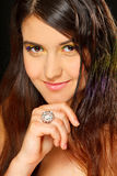 Portrait of lovely girl with ring on hand. Portrait of young lovely girl with ring on hand Royalty Free Stock Photos