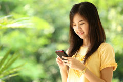 Portrait lovely girl type information with her mobile phone Stock Photos