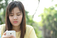 Portrait lovely girl type information with her mobile phone Royalty Free Stock Photo