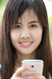 Portrait lovely girl type information with her mobile phone Stock Image