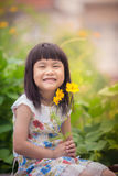 Portrait of lovely girl with yellow cosmos flower bouquet in han Stock Image