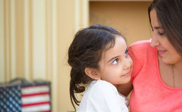 Portrait of lovely hispanic mother and daughter. At home Stock Images