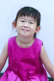 Portrait of a lovely little asian girl smiling and looking at ca Royalty Free Stock Photography