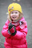 Portrait of a lovely little blonde girl with yellow hat Stock Photography