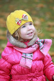 Portrait of a lovely little blonde girl with yellow hat Royalty Free Stock Image