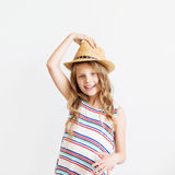 Portrait of a lovely little girl against a white background Stock Photos