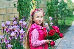 A pretty girl holding a peony flowers royalty free stock photography