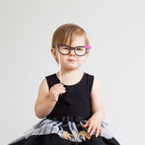 Portrait of a lovely little girl with funny photo props paper gl Royalty Free Stock Photography