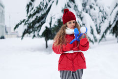 Portrait of lovely little girl holding snowball maker Royalty Free Stock Image
