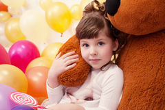 Portrait of lovely little girl hugging teddy bear Stock Image