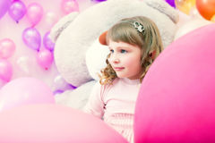 Portrait of lovely little girl posing in playroom Royalty Free Stock Photos