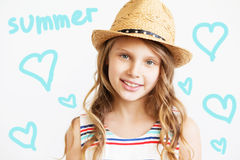 Portrait of a lovely little girl with straw hat against a white Royalty Free Stock Photography