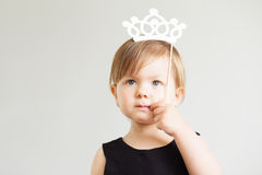Portrait of a lovely little girl with white paper crown Stock Photos