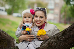 Portrait lovely mom and daughter in warm day Royalty Free Stock Photography