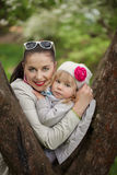 Portrait lovely mom and daughter in warm spring day Royalty Free Stock Photo