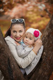 Portrait lovely mom and daughter in warm  sunny autumn day Royalty Free Stock Images