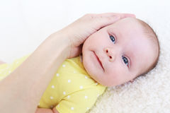 Portrait of lovely 2 months baby girl with mothers hand stock photos
