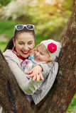 Portrait lovely mother and child together outdoors Stock Images