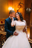 Portrait of lovely newlyweds in vintage classic interior Royalty Free Stock Photography
