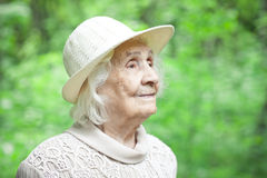 Portrait of a lovely old woman smiling outdoors Royalty Free Stock Images