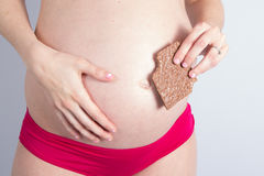 Portrait of lovely Pregnant woman. With big chocolate stock images