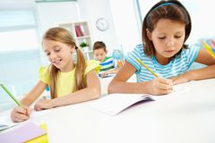 Girls drawing Stock Photography