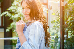 Portrait of lovely smiling woman in profile Stock Photos
