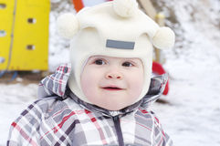 Portrait of lovely warm dressed baby outdoors Royalty Free Stock Photo