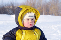Portrait of lovely warm dressed baby in winter Royalty Free Stock Images