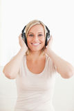 Portrait of a lovely woman enjoying some music. Against a white background Stock Image
