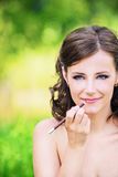 Portrait of lovely woman making Royalty Free Stock Image