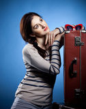 Portrait of the lovely woman in retro style. Portrait of the lovely woman with suitcases in retro style Royalty Free Stock Photography