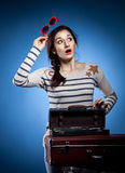 Portrait of the lovely woman in retro style. Portrait of the lovely woman with suitcases in retro style Stock Image