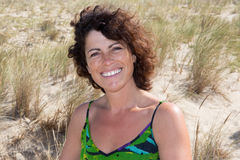 Portrait of lovely 40-year-old brunette woman at beach Royalty Free Stock Photography