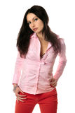 Portrait of lovely young brunette in pink shirt Royalty Free Stock Images