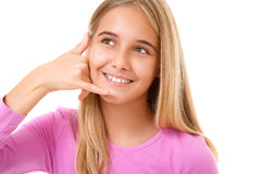 Portrait of lovely young girl taking a call me gesture.Isolated Stock Photography