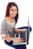 Portrait of a lovely young woman  with laptop looking up Royalty Free Stock Image