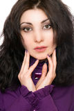 Portrait of lovely young woman in a purple jacket. Isolated Stock Photos