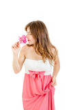 Portrait of lovely young woman smelling rose Royalty Free Stock Photo
