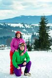 Portrait of a lover of a pair of skiers in an outfit on the top of the Carpathian Mountains stock image