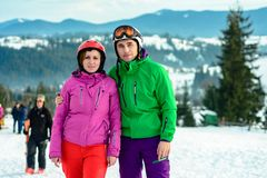 Portrait of a lover of a pair of skiers in an outfit on the top of the Carpathian Mountains royalty free stock photo