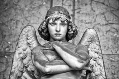 Portrait of loving angel on marble, monumental cemetery of Genoa, Italy, one of the most important monumental cemeteries in Europe royalty free stock images
