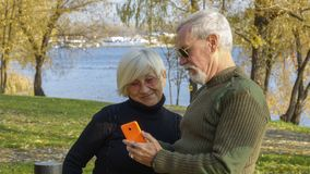 Portrait of a loving couple with a smartphone Stock Images