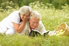Portrait of loving elderly couple having a picnic stock photo