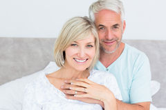 Portrait of a loving mature couple in bed Royalty Free Stock Image