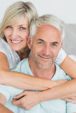 Portrait of a loving mature couple in bed Stock Photo
